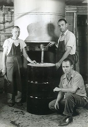 Co-Founder with employees in manufacturing facility